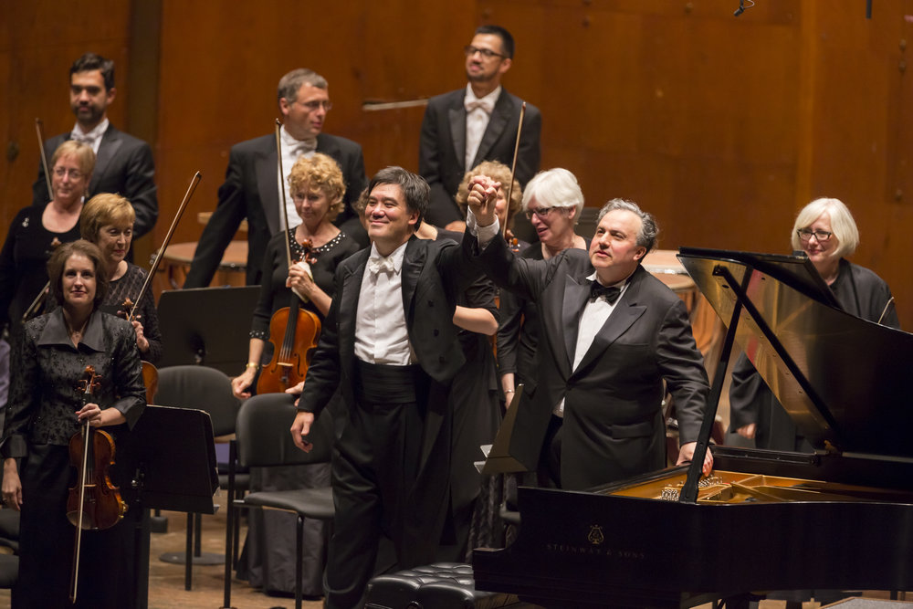 Pianist Yefim Bronfman's residency (2013–14) integrated Alan Gilbert's signature initiatives. The Artist-in-Residence performed on  CONTACT!,  the new-music series, and was the featured soloist in  The Beethoven Piano Concertos:  A Philharmonic Festival, the three-week showcase of Beethoven's complete piano concertos, plus Triple Concerto, alongside World Premieres commissioned by the Philharmonic. Bronfman also reprised former Composer-in-Residence Magnus Lindberg's Second Piano Concerto — a Philharmonic commission that the pianist premiered with the Orchestra two years before — in New York and Asia.