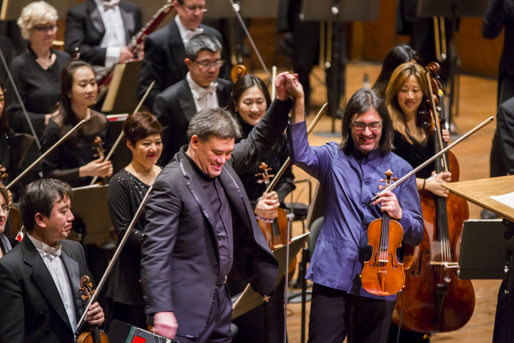 The final Artist-in-Residence of Alan Gilbert's tenure, violinist Leonidas Kavakos (2016–17) not only appears as a violinist, but also made his Philharmonic conducting debut leading works by Busoni and Schumann in addition to leading a J.S. Bach concerto from the violin. He also premiered a new violin concerto by Lera Auerbach, commissioned for him by the Philharmonic; appeared in a Young People's Concert; and gave a recital.