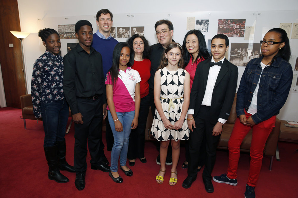 The inaugural Harmony All Stars Ensemble — nine middle- and high-school students from low-income neighborhoods in New York City selected by audition — participated in an 11-day mentorship with Philharmonic musicians. They attended a Philharmonic rehearsal, performed with their Philharmonic mentors at a free public concert, and met Alan Gilbert after a Young People's Concert (pictured).