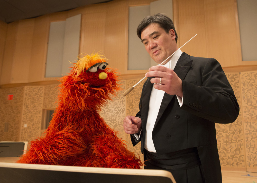 In 2013 Alan Gilbert went to  Sesame Street,  where he showed Murray Monster and Ovejita how an orchestra works and what happens when he raises his baton. He introduced them to  Eine kleine Nachtmusik  — which the Music Director himself first heard on  Sesame Street  as a child.