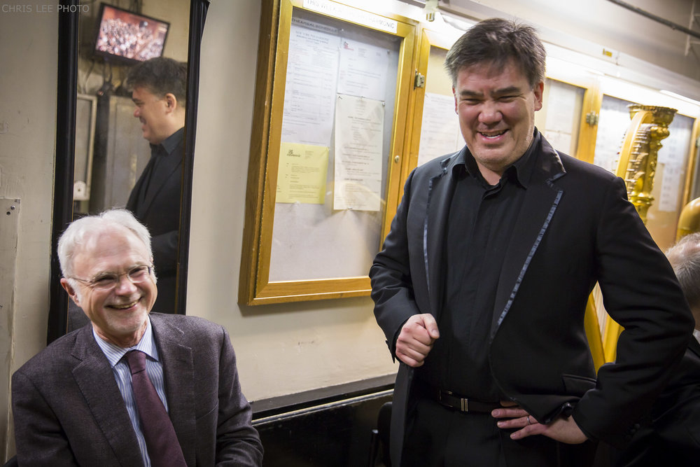 "Alan Gilbert has a longstanding association with John Adams, whom the Music Director has called ""the Dean of American Composers."" The year before he arrived at the Philharmonic, in the fall of 2008, Gilbert made his acclaimed Metropolitan Opera debut in Adams's  Doctor Atomic  (the DVD and Blu-ray of which received the 2012 Grammy Award for Best Opera Recording). The two have collaborated during Gilbert's Philharmonic tenure, including in the 2015 World Premiere–Philharmonic Co-Commission of Adams's  Scheherazade.2  — Dramatic symphony for violin and orchestra, with Leila Josefowicz as soloist, and (in photo, March–April 2017), in a celebration of the Pulitzer Prize–winning composer's 70th birthday through performances of his works in New York, on a Young People's Concert, and on the EUROPE / SPRING 2017 tour."