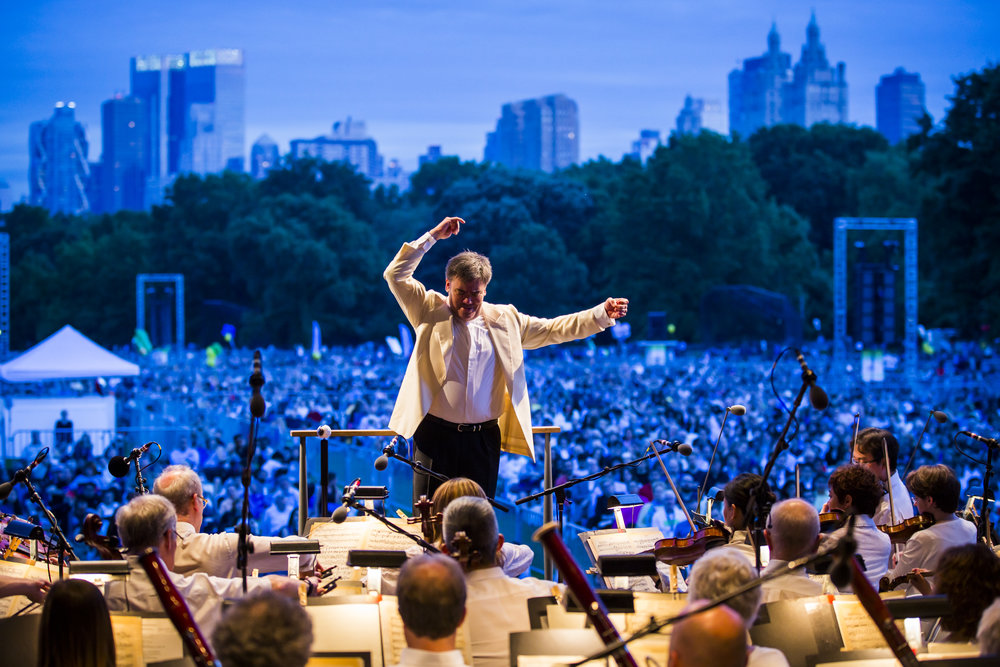 Alan Gilbert has conducted 24 performances in New York City's vernal oases, many of them setting the Manhattan skyline as the backdrop for works such the Prelude and  Liebestod  from Wagner's  Tristan und Isolde,  performed in 2016.