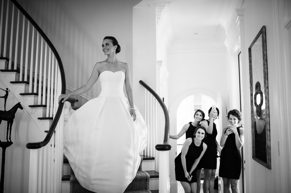 bridesmaids seeing kiawah island bride for the first time in wedding gown