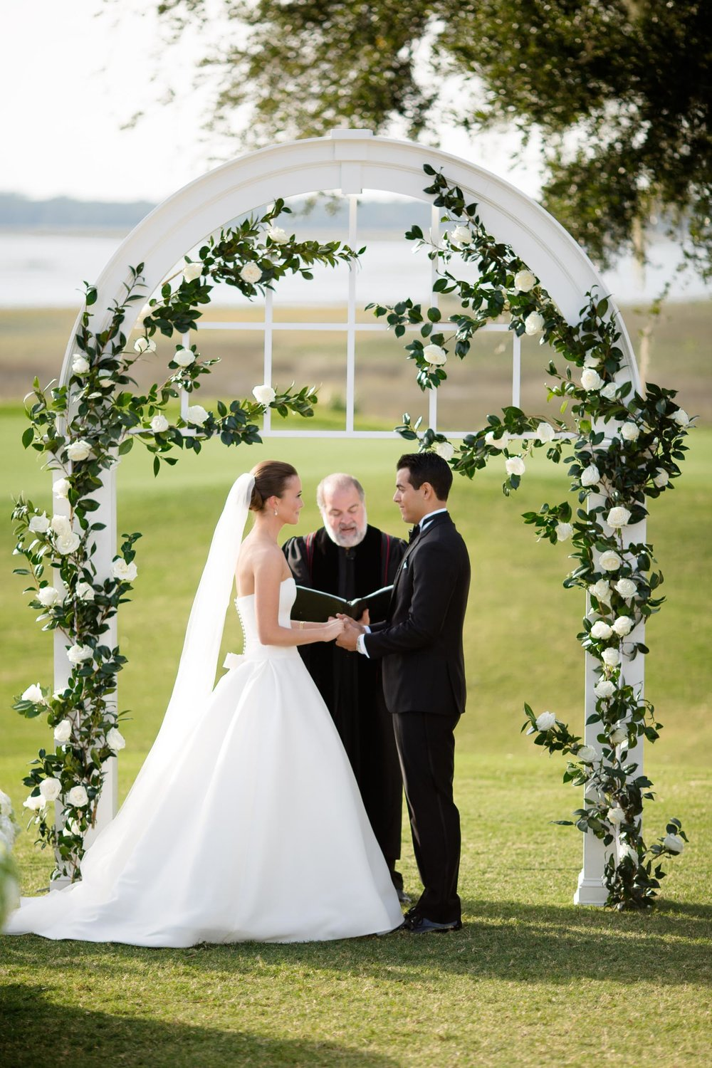 Floral wedding ceremony arch for Kiawah Island wedding.
