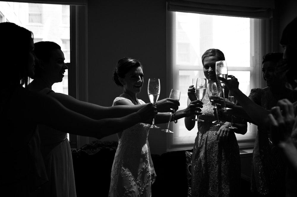 Bridesmaids toast champagne before wedding at Morgan Manufacturing.