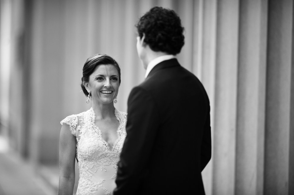 A groom sees his bride for the first time on their wedding day in downtown Chicago, Illinois.