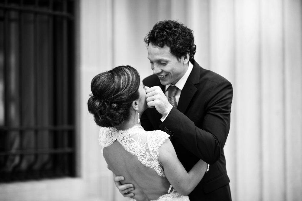 A candid documentary wedding photo in Chicago of a bride and groom seeing each other for the first time on their wedding day.
