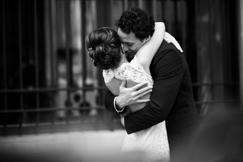 A bride and groom embrace during their first look in downtown Chicago, before their wedding at Morgan Manufacturing.