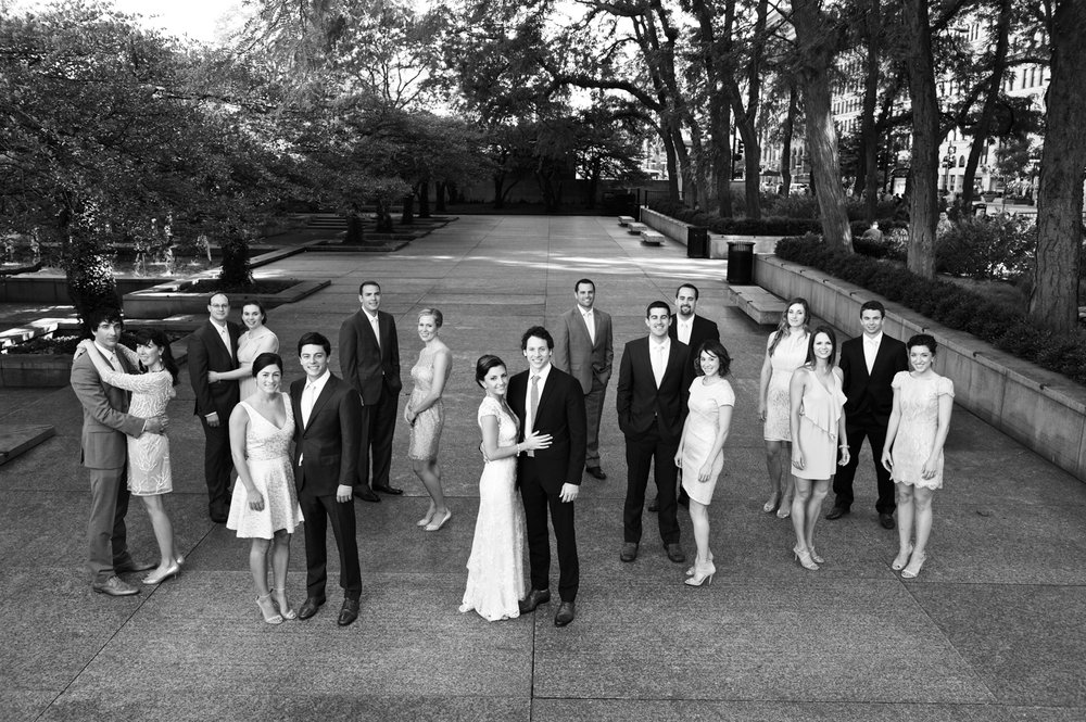 Black and white photo of a wedding party at the Art Institute Chicago gardens.
