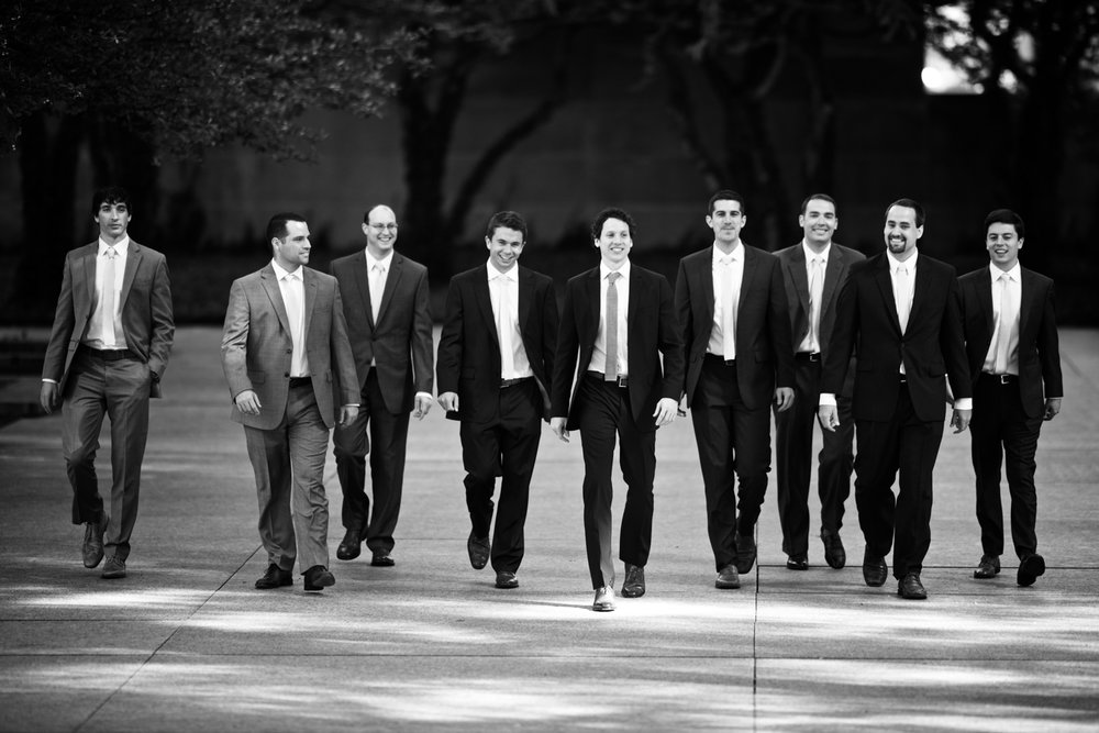 Candid portrait of groomsmen before wedding at Morgan Manufacturing Chicago.