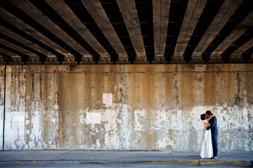 Wedding photo of bride and groom in urban setting in Chicago.