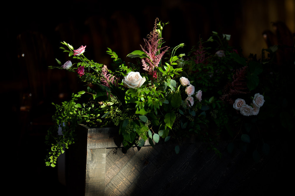 Aisle floral decor at Morgan Manufacturing for wedding ceremony.