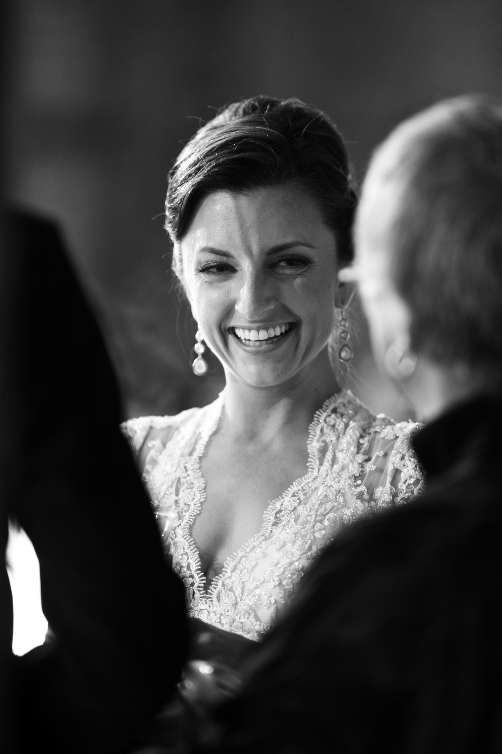 Bride laughs during wedding ceremony at Morgan Manufacturing in Chicago.