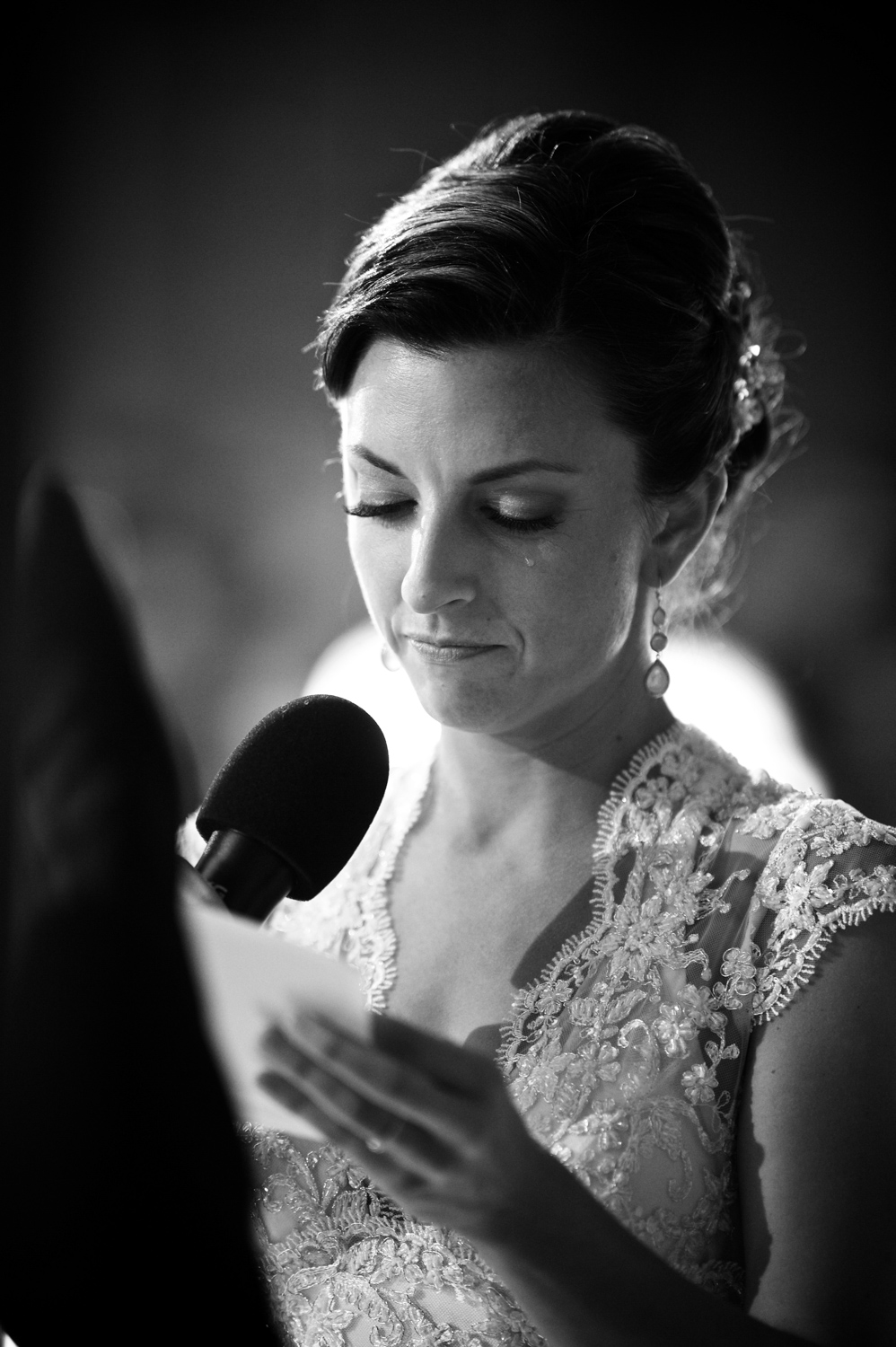 Bride cries during wedding ceremony at Morgan Manufacturing Chicago.
