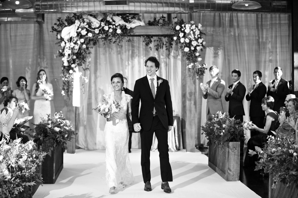 Bride and groom exit wedding ceremony at Morgan Manufacturing.