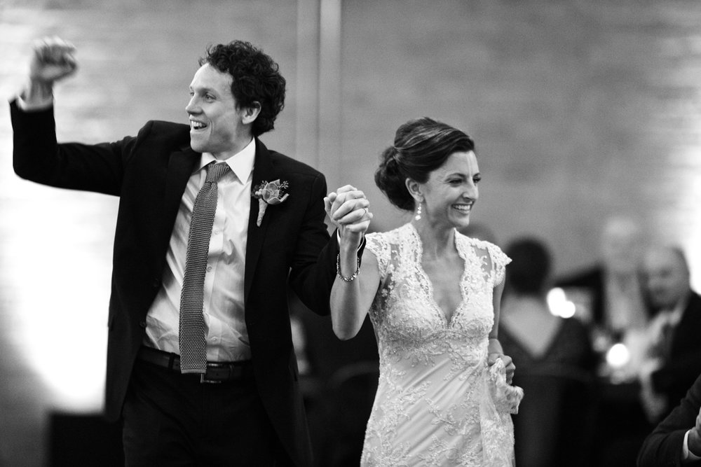 Bride and groom enter wedding reception at Morgan Manufacturing in Chicago.