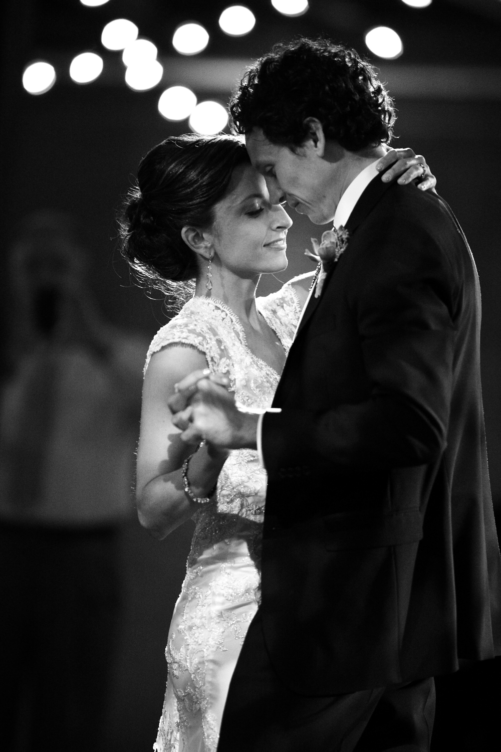 Black and white photo of bride and groom dancing during their wedding at Morgan Manufacturing