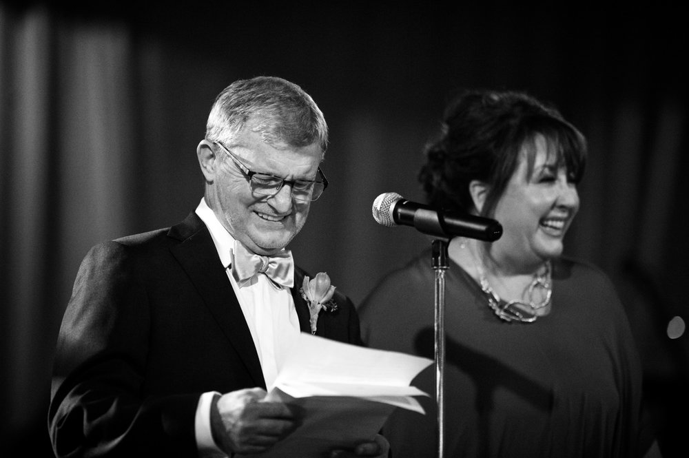 Parents of the bride give a toast during wedding reception at Morgan Manufacturing