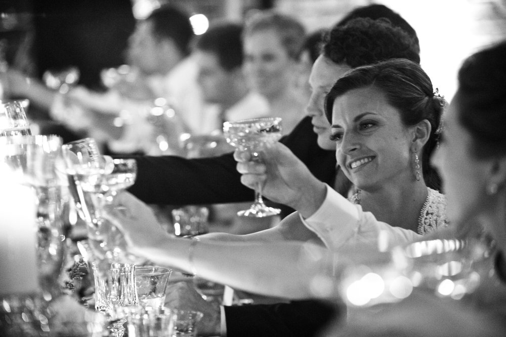 Photo of a bride and groom toasting champagne at Morgan Manufacturing wedding.