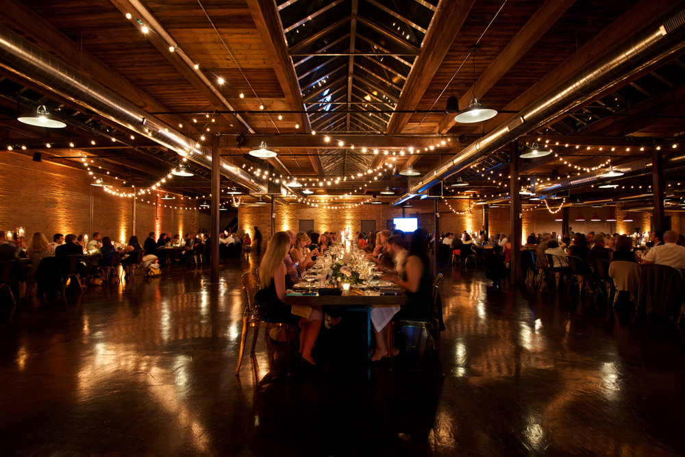 Photograph of wedding reception room during dinner at Morgan Manufacturing.