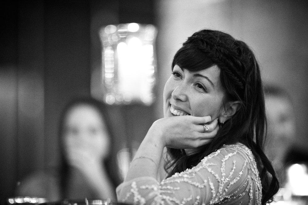 Bridesmaid reacts to toast at Morgan Manufacturing wedding.