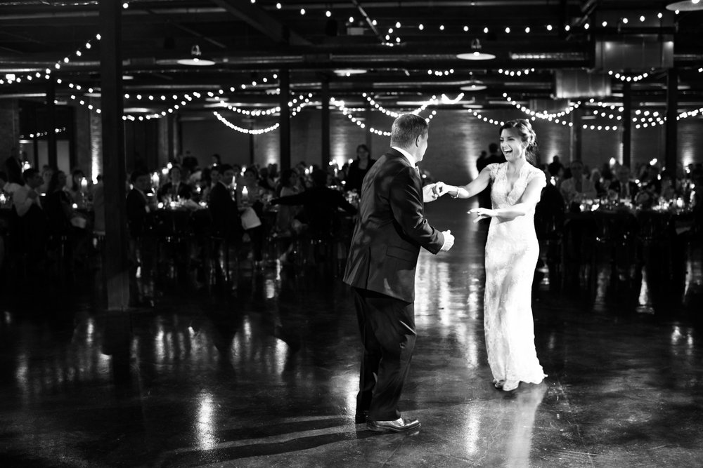 The father + daughter dance during a wedding reception at Morgan Manufacturing.