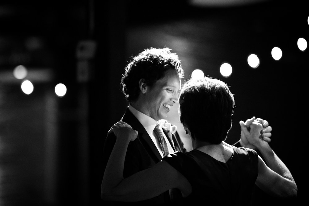 A groom dancing with his mother during wedding reception at Morgan Manufacturing in Chicago.