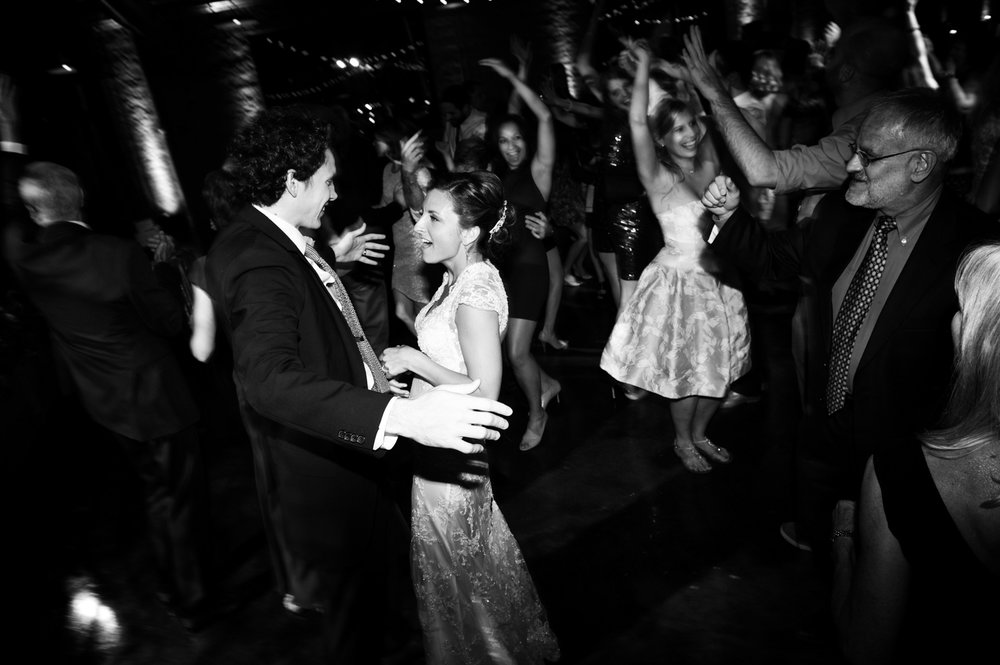 Bride and groom dancing with guests at Morgan Manufacturing.