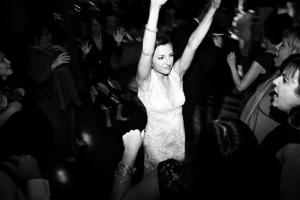 Documentary wedding photography of bride dancing at wedding in Chicago