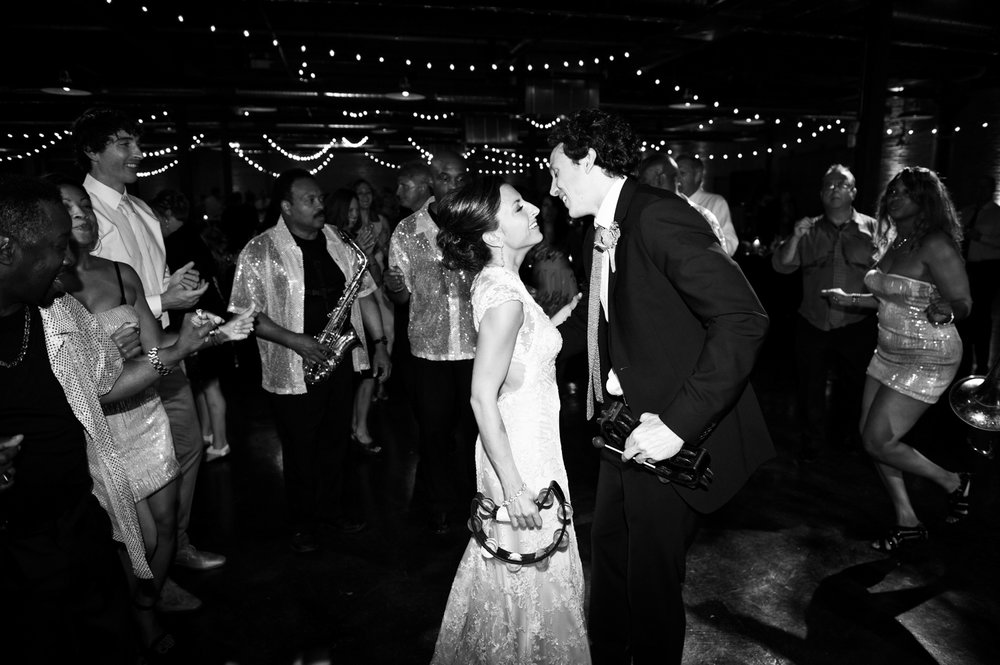 Bride and groom dance at Morgan Manufacturing wedding