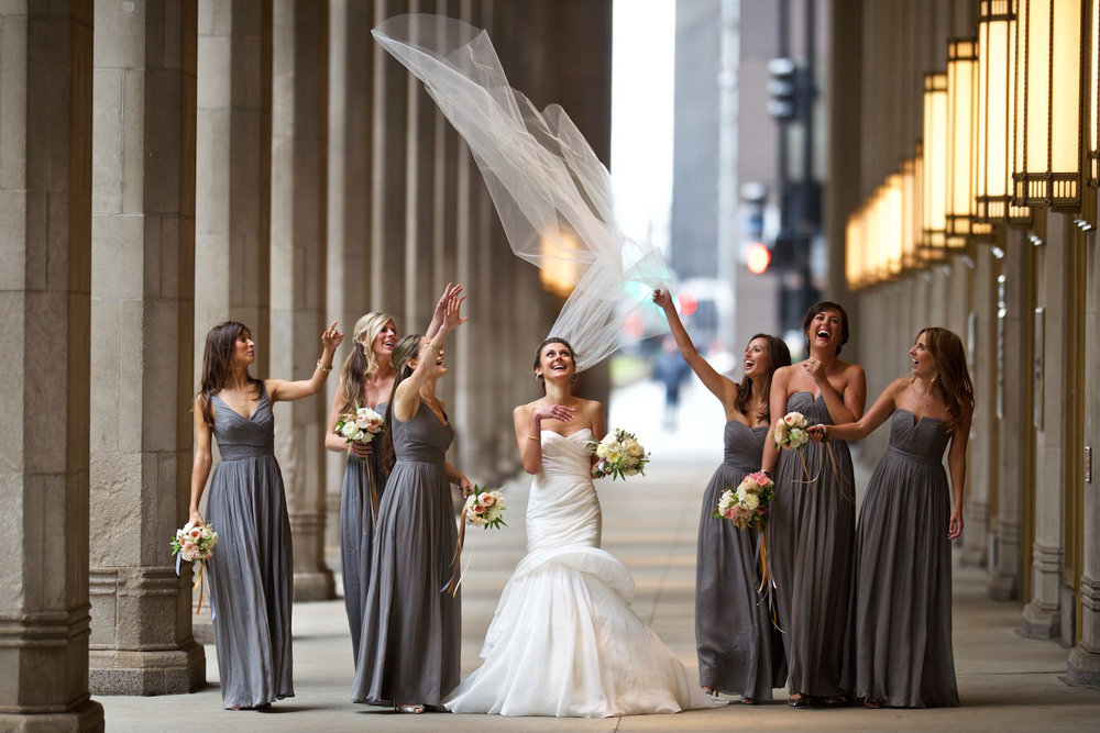 Photojournalistic bridal party portrait at Lyric Opera in Chicago.
