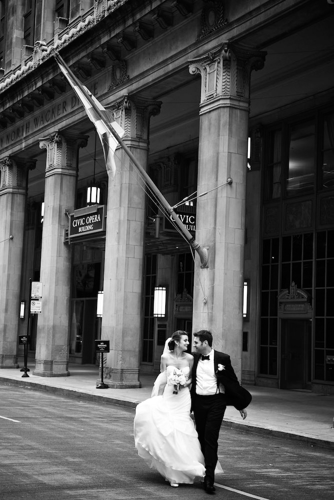 Black and white portrait of bride and groom at Civic Opera Building