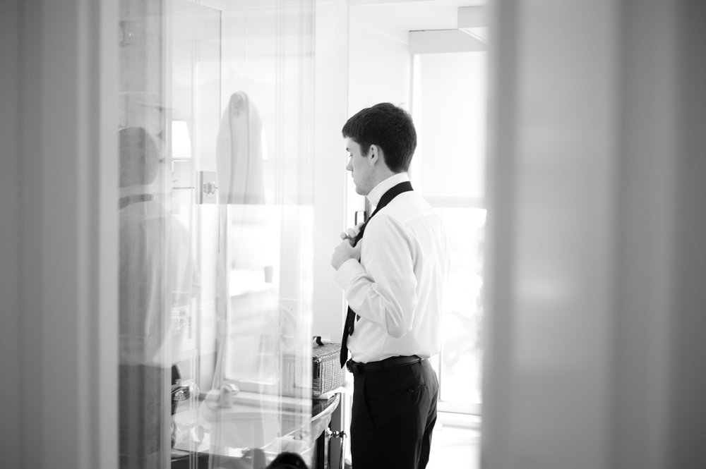 Groom gets ready for wedding at the Peninsula Hotel in Chicago