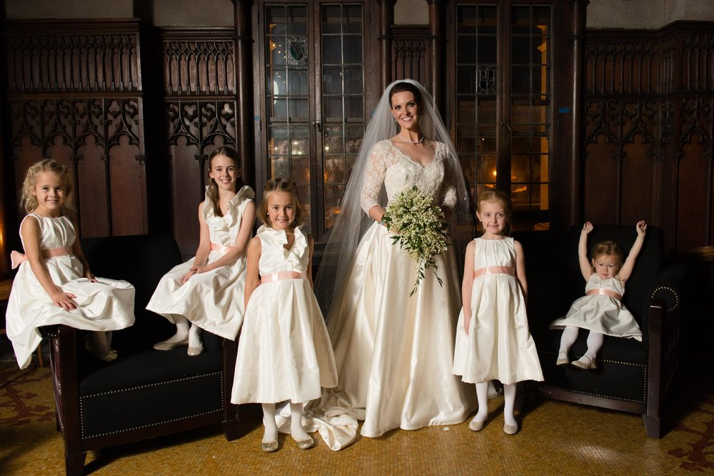 Classic portrait of a bride and flower girls at a Chicago Athletic Association Wedding