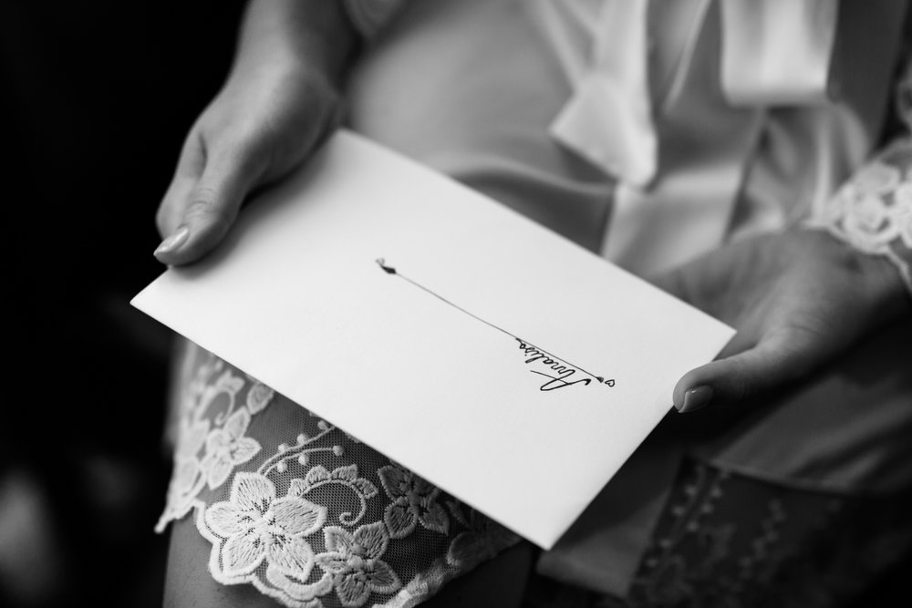 Bride holding a letter from her fiance.