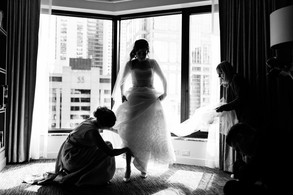 Photojournalistic photograph of bride getting ready for her wedding at Harris Theater Rooftop Millennium Park Chicago.