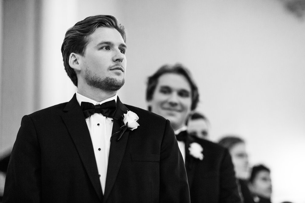 Groom at wedding ceremony at St James Lutheran Church in Chicago