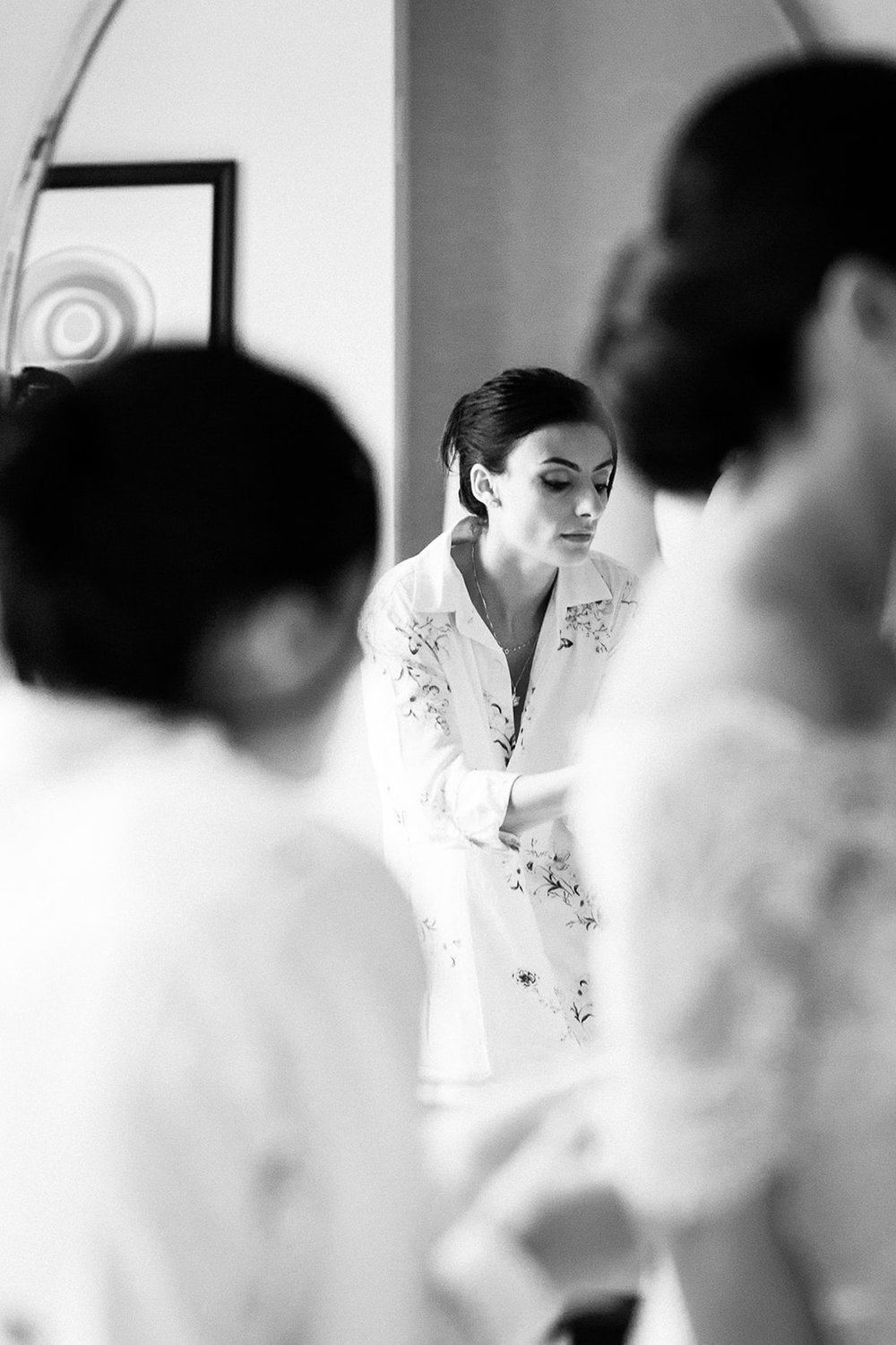 Sister helps her sister dress for wedding at the Langham in Chicago