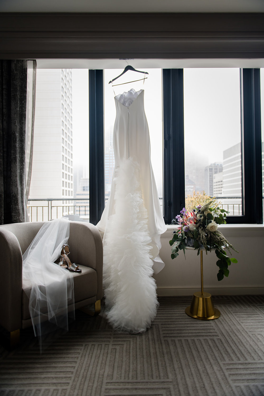 Bride's accessories and gown displayed at the Gwen Hotel in Chicago, Illinois