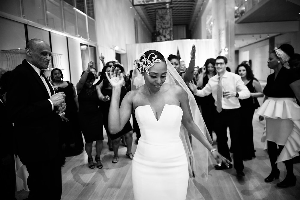 Bride dances at her downtown Chicago wedding to music by DJ Kel-win