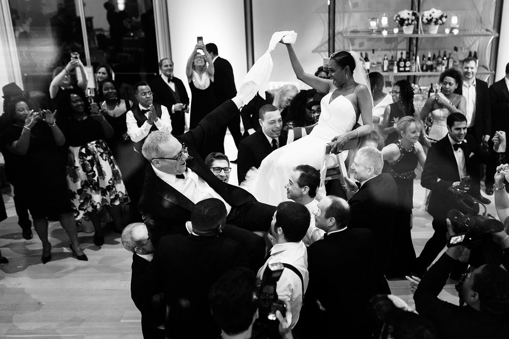 Multi racial wedding hora at the Art Institute of Chicago