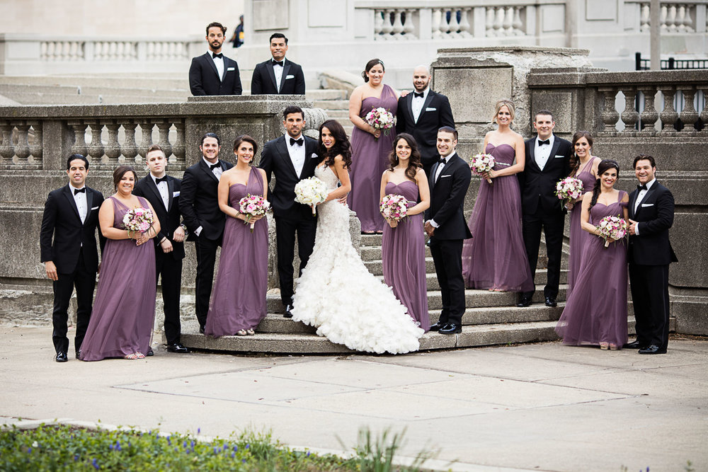 We've had many brides come to us concerned that their wedding party might be too large to get nice photos of the entire group in downtown Chicago. Locations like the steps here in Grant Park make it easy for us to vary heights and frame the couple with their closes friends.
