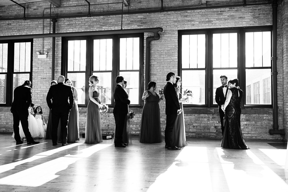 We love documentary photos like this which show the behind the scenes of a wedding day as the wedding party and family line up for the ceremony which was about to begin.