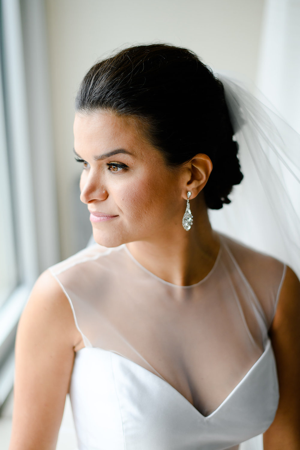 Minimalist bridal portrait near a window at the Four Seasons in Chicago