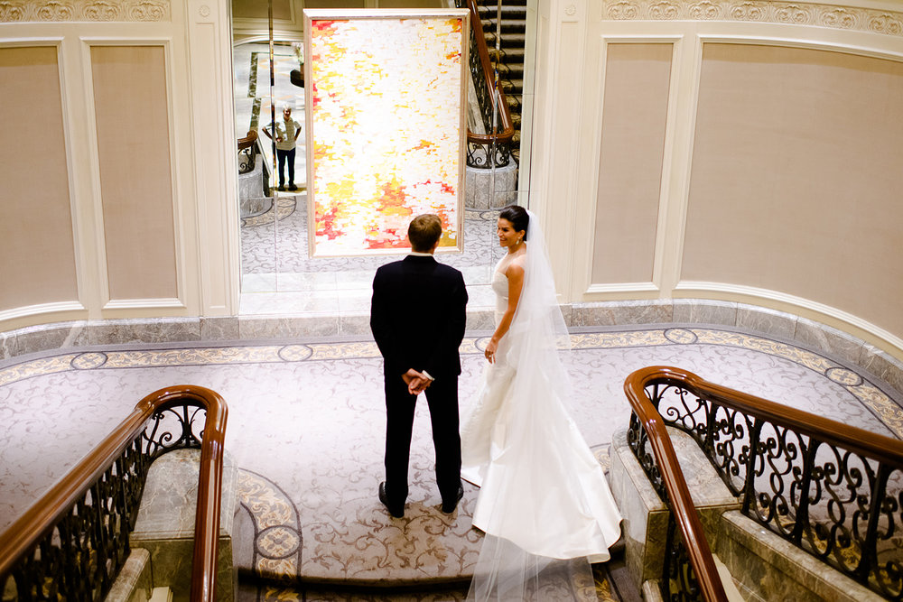 We love the Four Seasons in Chicago because it is one of the best hotels to get ready at for your wedding day. This staircase is an excellent indoor first look location in Chicago!