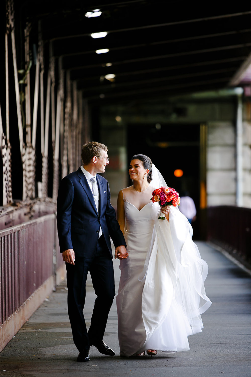 Lower Michigan Ave is one of our secret hidden photo locations. Even on the busiest weekends in the city (like Labor Day weekend) it is never crowded and it's also covered so it's a great rainy day wedding photo location spot!
