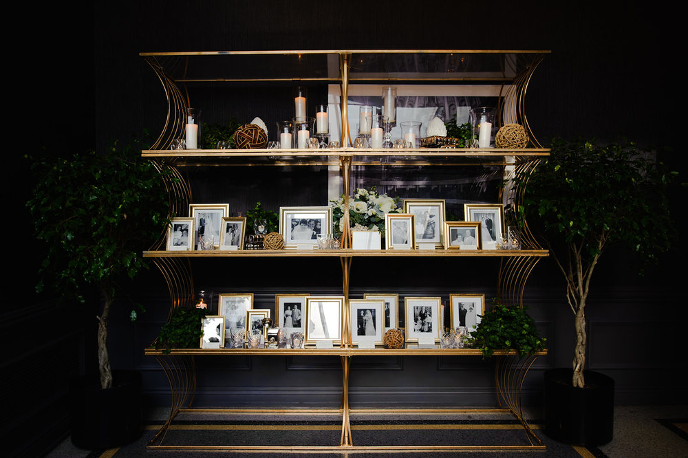 Love this classy heritage photo shelf that the couple set in the entrance to the venue. Vintage photographs of their family through the generations greeted their guests as they arrived at the Ivy Room.