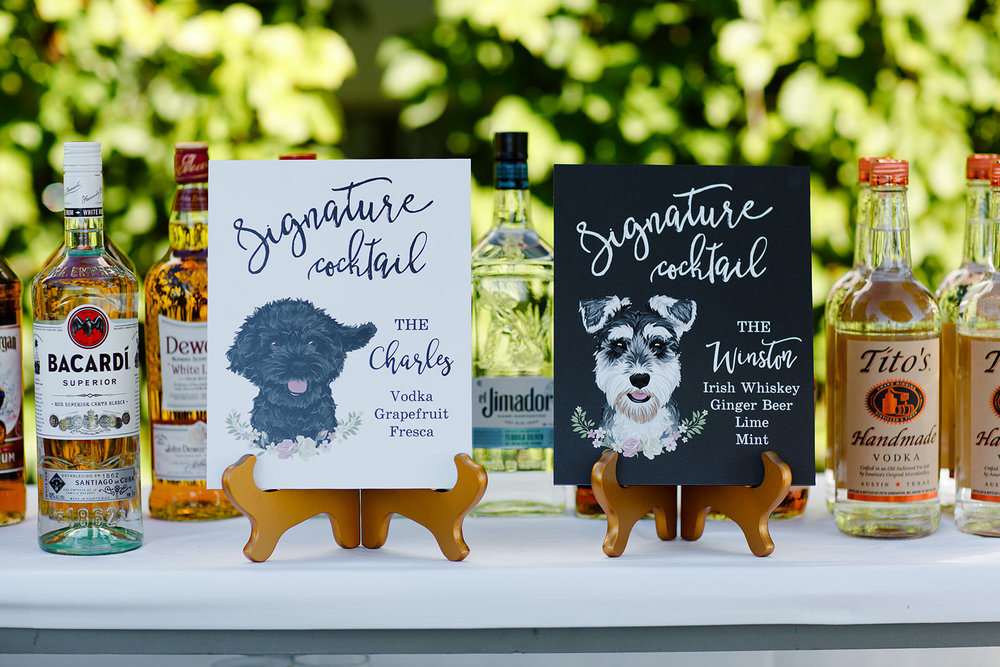 Their bar signs featured hand-painted illustrations of the couple's beloved dogs, Charles and Winston.