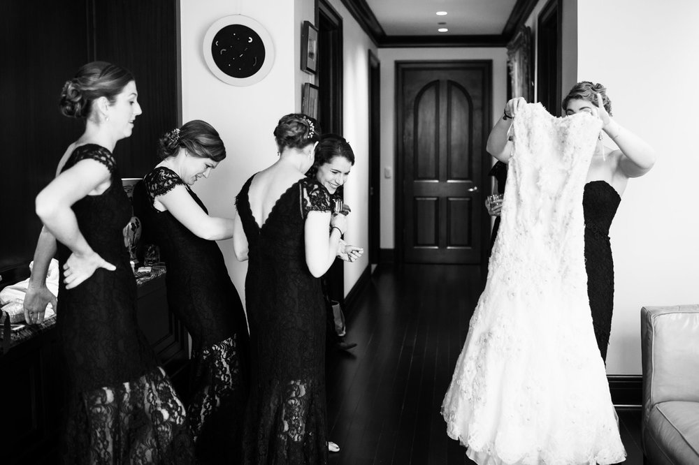 The bride and her bridesmaids dressed at her family condo in the Gold Coast of Chicago.