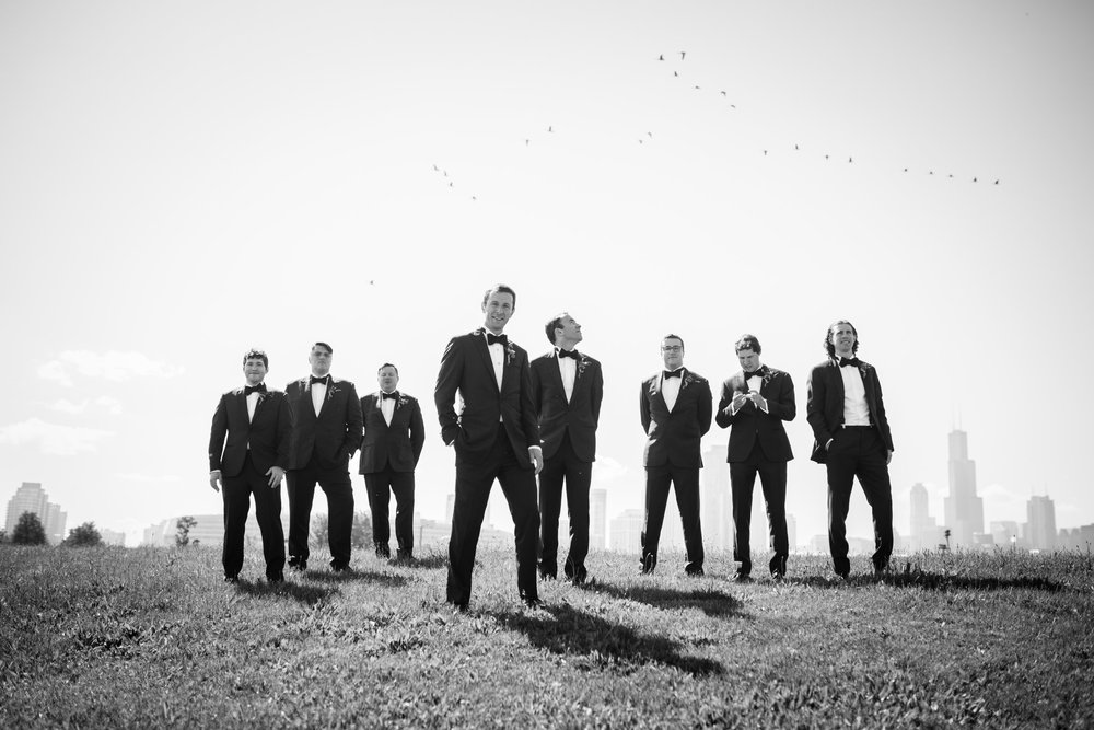 Northerly Island weddings are wonderful because we get to utilize so many various photo locations. The Sears Tower and Chicago skyline are in the distance. This shot is one of our favorite editorial photos of a group of groomsmen with a perfectly-timed flock of geese flying through the frame above them.